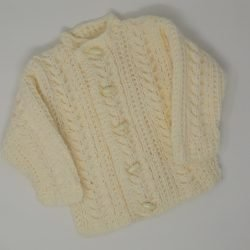 Aran Baby Cardigan Jacket For Boys and Girls A warm Aran round neck  baby jacket made in the colour of your choice for either boys or girls.